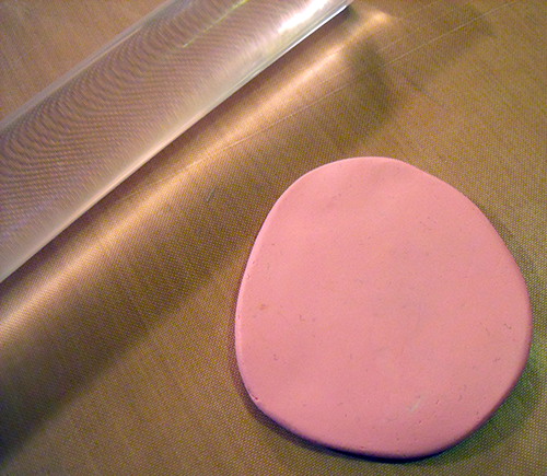 Flatten A Ball Of Conditioned Polymer Clay To A 1/2 Inch Thickness